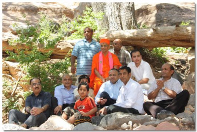Acharya Swamishree gives darshan with disciples