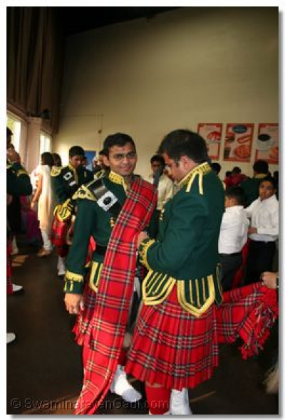 Members of Swamibapa Pipe Band get ready for their performance