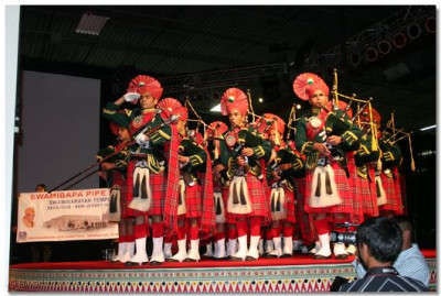 Swamibapa Pipe Band performs on stage
