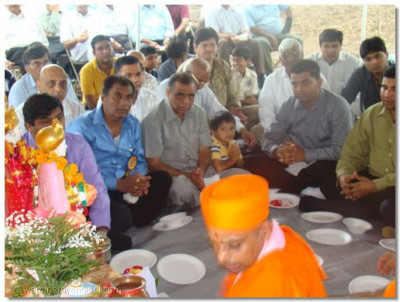 Sants and disciples perform the maha pooja at the temple site