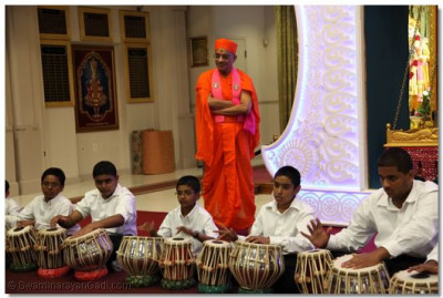 Young disciples who have been participating in tabla lessons at the temple perform for Acharya Swamishree