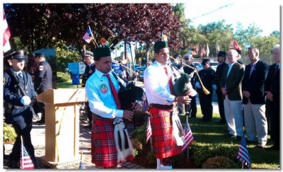 Members from Swamibapa Pipe Band lead the memorial procession