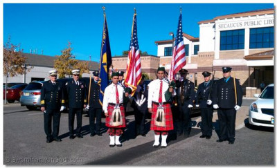 Swamibapa Pipe Band members with United States Armed Forces officers