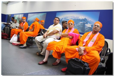Acharya Swamishree, sants, and disciples  await their departure for the United States