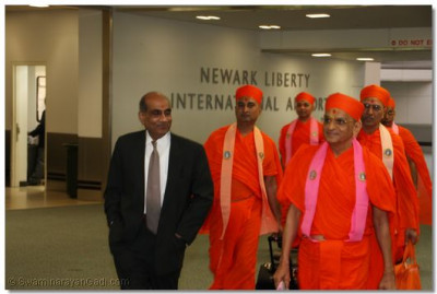 Acharya Swamishree and sants arrive at Newark Liberty Airport and are greeted by disciples