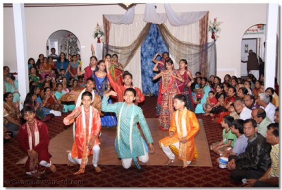 Young disciples perform a devotional dance to please Swaminarayanbapa Swamibapa