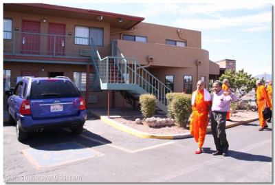 Acharya Swamishree walks around a disciple's hotel