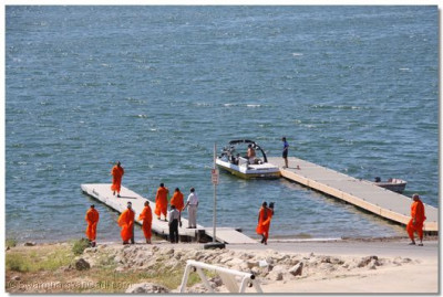 Acharya Swamishree, sants, and disciples at the lake area