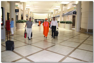 Acharya Swamishree and disciples departing for Alanta, Georgia