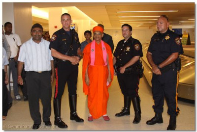 His Divine Holiness Acharya Swamishree gives darshan with the Hudson County Sheriff