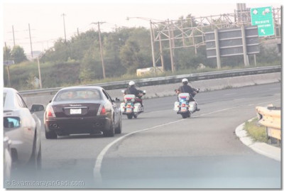His Divine Holiness Acharya Swamishree is given a police escort through the main highways of New Jersey towards Secaucus
