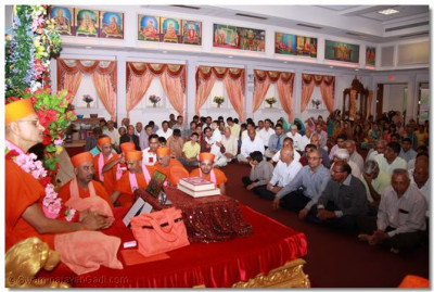 His Divine Holiness Acharaya Swamishree bestows his divine blessings on all