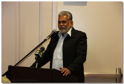 Guest of honor Mr. Parshottam Rupala speaks to the disciples
