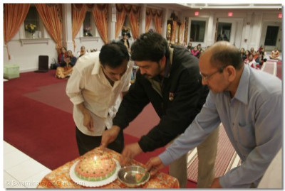 Event sponsors light a cake to celebrate Lord Swaminarayan's birthday