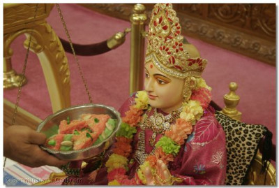 Lord Swaminarayan is presented with a Farari Birthday Cake