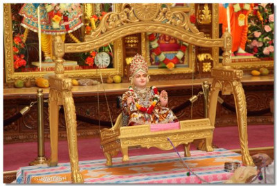 Lord Swaminarayan gently sways on a swing