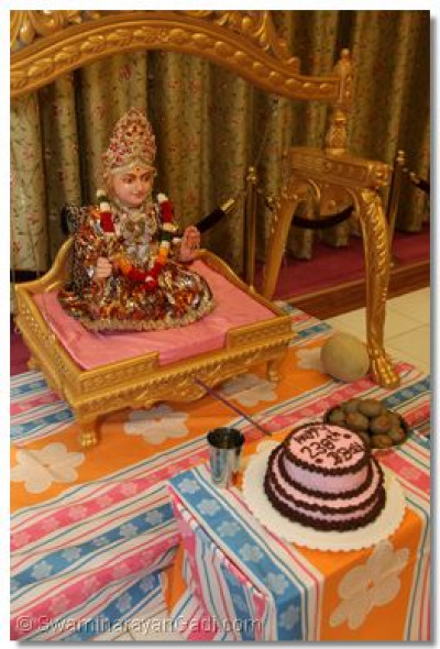 Lord Swaminarayan is presented with a birthday cake