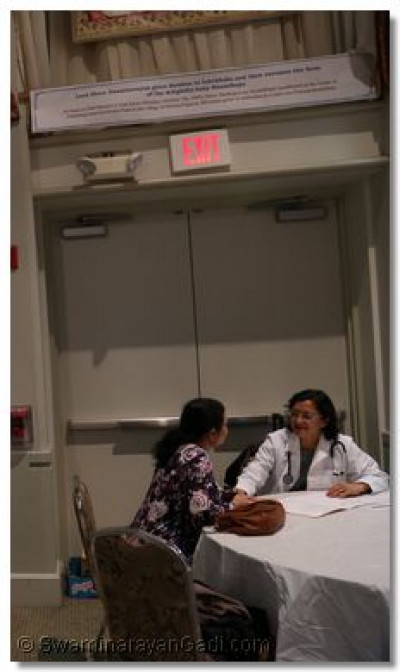 A doctor consults with a patient