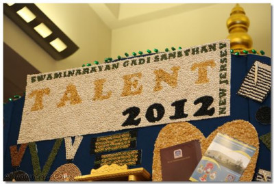 A large sign made out of beans displaying the SGS Talent 2012 logo among other designs displaying aspects of the competitions