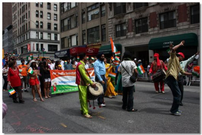 Dhol players excite the crowd with bhangra beats, and people join in and dance