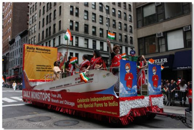 Air hostesses and representatives from Air India have their own float