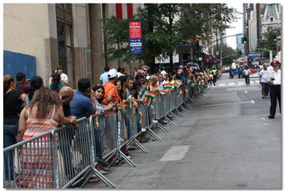 Thousands of Indians from all across America throng the sidewalks to watch the spectacular parade go down Madison Avenue