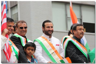 Bollywood actor Saif Ali Khan - the parade's Grand Marshall, watches the band's performance at the grandstand