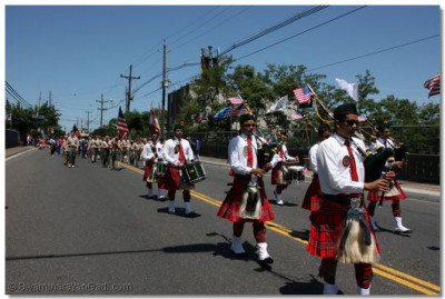 Swamibapa Pipe Band leads the parade down Paterson Plank Road
