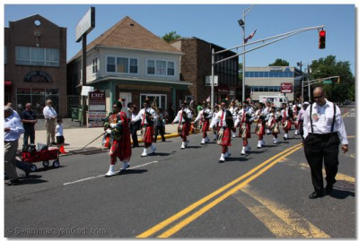 Swamibapa Pipe Band marching into the main Secaucus Business District
