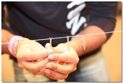 Disciples were challenged to balance nails on a piece of string