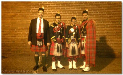 Bagpipes instructor Barry C. Freeman and Swamibapa Pipe Band members who performed at the memorial service