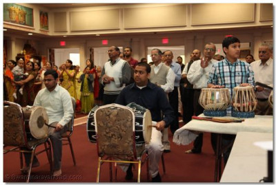 The dhol players  play to please Lord Shree Swaminarayan duringthe dhoon
