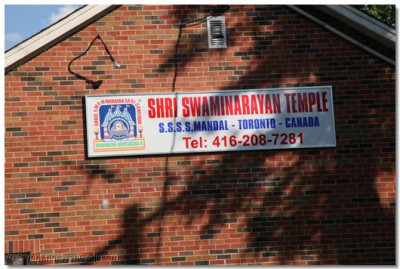 The temple sign with the Swaminarayan Gadi logo has already been installed