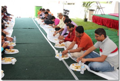 Disciples enjoy prasad after the celebrations