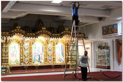 Disciples prepare the lighting display for the Diwali annkut celebrations