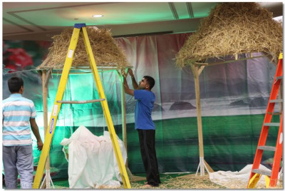 "Disciples construct a ""jhumpdi"" or a village-style hut for the Diwali annkut celebrations"