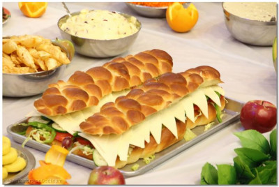 Among the American delicacies offered to Lord Swaminarayanbapa Swamibapa, an enormous sandwich stands out among the sweets