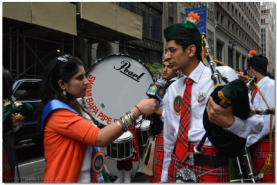 A member of Swamibapa Pipe Band is interviewed by TV Asia