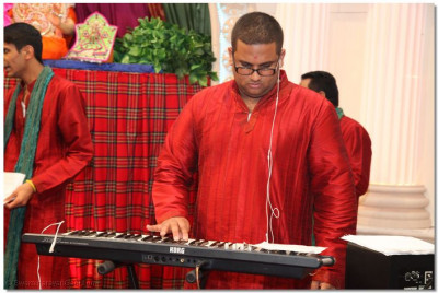 A disciple plays the piano to please Lord Swaminarayanbapa Swamibapa