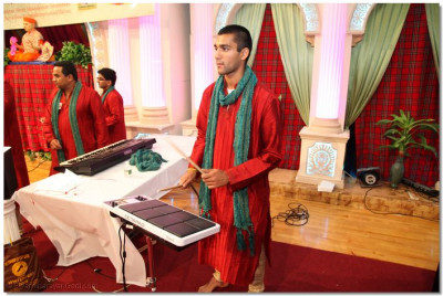 A disciple plays the octopad electronic drum to please Lord Swaminarayanbapa Swamibapa