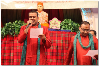 A disciple sings a kirtan to please Lord Swaminarayanbapa Swamibapa
