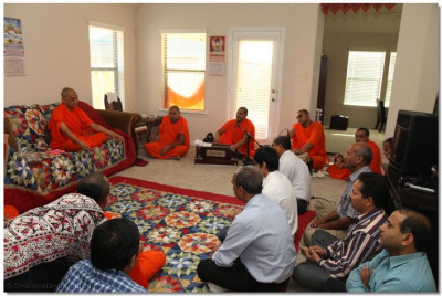 Acharya Swamishree and sants commence a sabha at a disciple's home