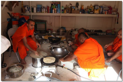 Just as they did along the entire vicharan, sants prepare lunch in a disciple's home