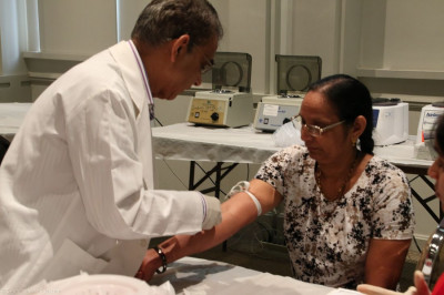 A volunteer doctor draws a patient�s blood for a comprehensive blood test