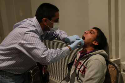 A doctor provides dental exams to all patients