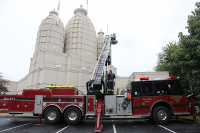 Secaucus Fire Department assists in raising the new flags over the temple domes