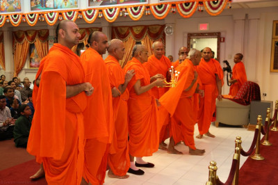 Acharya Swamishree and sants perform annkut aarti to Lord Swaminarayanbapa Swamibapa