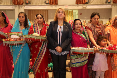 Assemblywoman Angelica Jimenez stands alongside disciples who present chhaab offerings to the Lord