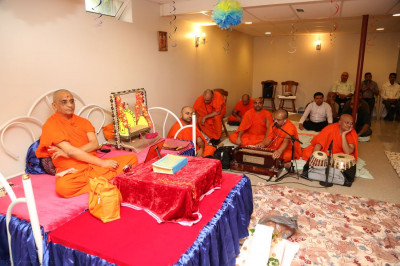 Acharya Swamishree and sants enjoy the performance