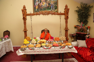 Divine darshan of Acharya Swamishree enjoying annkut items